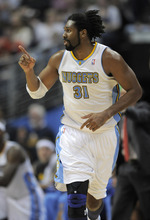 Denver Nuggets center Nene, from Brazil, reacts after hitting a 3-point shot against the Utah Jazz during the second quarter of an NBA basketball game Wednesday, Dec. 28, 2011, in Denver. (AP Photo/Jack Dempsey)