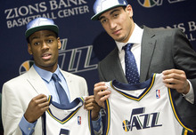 Djamila Grossman  |  The Salt Lake Tribune  The two new Jazz players, Enes Kanter and Alec Burks, hold up their new jerseys during a press conference Friday, June 24, 2011, at the Zions Bank Basketball Center in Salt Lake City, a day after the 2011 NBA draft.