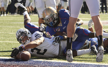 Rick Egan  | The Salt Lake Tribune   Brigham Young Cougars wide receiver Cody Hoffman (2) stretches into the endzone for a BYU touchdown with 12 seconds left in the first half, in football action in the Armed Forces Bowl, BYU vs. Tulsa, in Dallas, Texas, Friday, December 30, 2011