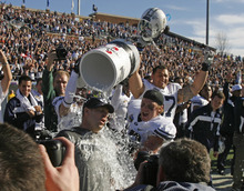 Rick Egan  | The Salt Lake Tribune   Brigham Young Cougars head coach Bronco Mendenhall gets drenched with Powerade as BYU celebrates their 24-21 win over Tulsa in the Armed Forces Bowl, in Dallas, Texas, Friday, December 30, 2011