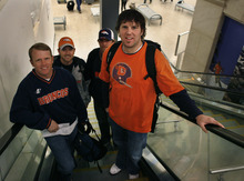 Scott Sommerdorf  |  The Salt Lake Tribune              Jon Kraus, right, of Logan, and friends, Regan Hoth, front left, and Ryan and Rusty Hoth behind, go up the escalator at Salt Lake International airport to take their flight to Denver to see the Broncos play the Patriots, Sunday, December 18, 2011.