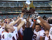 Illinois players lift the trophy after beating UCLA 20-14 in the Fight Hunger Bowl NCAA college football game in San Francisco, Saturday, Dec. 31, 2011. (AP Photo/Marcio Jose Sanchez)