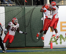 Illinois defensive back Terry Hawthorne (1) leaps in the air with Tavon Wilson, right, after Hawthorne's 39-yard interception return for a touchdown against UCLA during the third quarter in the Fight Hunger Bowl NCAA college football game in San Francisco,  Saturday, Dec. 31, 2011. Illinois won 20-14. (AP Photo/Marcio Jose Sanchez)