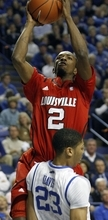 Louisville's Russ Smith (2) shoots over Kentucky's Anthony Davis during the first half of an NCAA college basketball game in Lexington, Ky., Saturday, Dec. 31, 2011. (AP Photo/James Crisp)