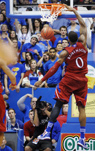 Kansas forward Thomas Robinson (0) dunks for two of his 30 points in the second half of their 84-58 win over North Dakota in an NCAA college basketball game in Lawrence, Kan., Saturday, Dec. 31, 2011. (AP Photo/Reed Hoffmann)
