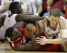 Ohio State's Evan Ravenel, middle, battles for a loose ball with Indiana's Victor Oladipo, left, and Cody Zeller during the first half of an NCAA college basketball game on Saturday, Dec. 31, 2011, in Bloomington, Ind. (AP Photo/Darron Cummings)