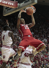 Ohio State's Amir Williams (23) dunks against Indiana's Victor Oladipo, left, during the first half of an NCAA college basketball game on Saturday, Dec. 31, 2011, in Bloomington, Ind. (AP Photo/Darron Cummings)