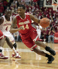 Ohio State's William Buford drives to the basket around Indiana's Victor Oladipo during the first half of an NCAA college basketball game Saturday, Dec. 31, 2011, in Bloomington, Ind. (AP Photo/Darron Cummings)