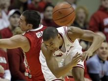 Indiana's Verdell Jones III, right, and Ohio State's Aaron Craft battle for a loose ball during the first half of an NCAA college basketball game on Saturday, Dec. 31, 2011, in Bloomington, Ind. (AP Photo/Darron Cummings)