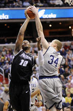 Providence forward Kadeem Batts (10) gets blocked by Georgetown forward Nate Lubick (34) during the first half of an NCAA college basketball game, Saturday, Dec. 31, 2011, in Washington. (AP Photo/Nick Wass)