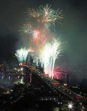 Fireworks burst over the Sydney Harbour Bridge during New Year's celebrations in Sydney, Sunday, Jan. 1, 2012. (AP Photo/Rick Rycroft)