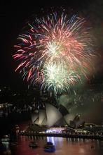 Fireworks burst over Sydney Opera House as New Year's celebrations begin in Sydney, Australia, Saturday, Dec. 31, 2011. (AP Photo/Rick Rycroft)