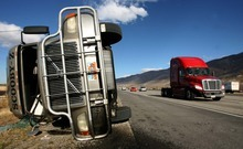 Leah Hogsten | The Salt Lake Tribune   A semitruck toppled in the wind on I-15 in Centerville. Hurricane-force winds, in places topping 100 mph, ripped through Utah on Thursday, overturning semi-trailer rigs on Interstate 15, toppling trees and triggering widespread power outages affecting nearly 50,000 homes and businesses.
