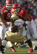 Trent Nelson  |  The Salt Lake Tribune Utah's Derrick Shelby tackles Georgia Tech's Charles Perkins during the fourth quarter as the University of Utah faces Georgia Tech, college football at the Sun Bowl in El Paso, Texas, Saturday, December 31, 2011.
