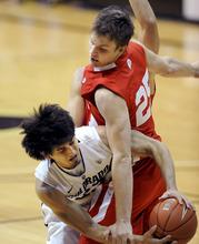 Colorado's Sabatino Chen, left, passes around Utah's Blake Wilkinson during the second half of an NCAA college basketball game, Saturday, Dec. 31, 2011, in Boulder, Colo. Colorado won 73-33. (AP Photo/The Daily Camera, Cliff Grassmick) NO SALES; NO MAGS; NO TV