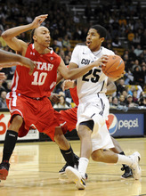 Colorado's Spencer Dinwiddie drives on Utah's Dijon Farr during the first half of an NCAA college basketball game, Saturday, Dec. 31, 2011, in Boulder, Colo. (AP Photo/The Daily Camera, Cliff Grassmick) NO SALES; NO MAGS; NO TV