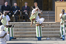 Paul Fraughton | The Salt Lake Tribune.  Alex Ngendakuriyo, performing with Jambo Africa Burundi Drummers at the swearing-in ceremony Tuesday, Jan. 3, 2012, for Salt Lake City Mayor Ralph Becker and three council members, leaps into the air during a dance for the ceremony.