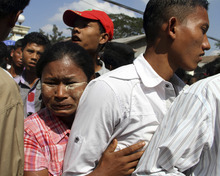 A woman hugs her son who came out of Myanmar's Insein prison in Yangon, Myanmar ,Tuesday, Jan. 3, 2012. Myanmar's government announced Monday that it is reducing the sentences of many prisoners, but stopped short of declaring an amnesty that had been expected by many people. (AP Photo/Khin Maung Win)