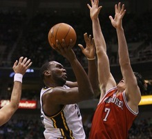 Steve Griffin  |  The Salt Lake Tribune  Utah's AL Jefferson drives into the Milwaukee defense during first half action of the Utah Jazz versus Milwaukee Bucks game at EnergySolutions Arena in Salt Lake City, Utah  Tuesday, January 3, 2012.