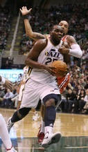 Steve Griffin  |  The Salt Lake Tribune  Utah's AL Jefferson drives past Milwaukee's Drew Gooden during first half action of the Utah Jazz versus Milwaukee Bucks game at EnergySolutions Arena in Salt Lake City, Utah  Tuesday, January 3, 2012.