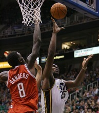 Steve Griffin  |  The Salt Lake Tribune  Utah's Al Jefferson scores over Milwaukee's Larry Sanders during first half action of the Utah Jazz versus Milwaukee Bucks game at EnergySolutions Arena in Salt Lake City, Utah  Tuesday, January 3, 2012.
