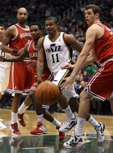Steve Griffin  |  The Salt Lake Tribune  Utah's Earl Watson passes the ball to the baseline during first half action of the Utah Jazz versus Milwaukee Bucks game at EnergySolutions Arena in Salt Lake City, Utah  Tuesday, January 3, 2012.
