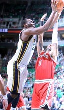 Steve Griffin  |  The Salt Lake Tribune  A photograpjer's strobe illuminates Utah's AL Jefferson as he shoots over Milwaukee's Drew Gooden during first half action of the Utah Jazz versus Milwaukee Bucks game at EnergySolutions Arena in Salt Lake City, Utah  Tuesday, January 3, 2012.