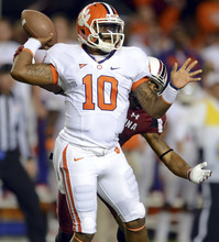 Clemson quarterback Tajh Boyd releases the ball as he is being hit by South Carolina's Stephon Gilmore during an NCAA college football game Saturday, Nov. 26, 2011, at William-Brice Stadium in Columbia, S.C. (AP Photo/ Richard Shiro)
