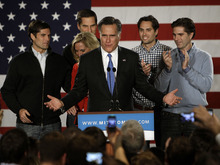 Republican presidential candidate, former Massachusetts Gov. Mitt Romney addresses supports with his family behind him during a Romney for President Iowa Caucus night rally in Des Moines, Iowa, Tuesday, Jan. 3, 2012. (AP Photo/Charlie Neibergall)