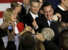 Republican presidential candidate, former Massachusetts Gov. Mitt Romney reaches for a supporters as his wife Ann looks one during a Romney for President Iowa Caucus night rally in Des Moines, Iowa, Tuesday, Jan. 3, 2012. (AP Photo/Charlie Neibergall)