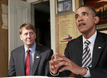 Haraz N. Ghanbari  |  The Associated Press President Barack Obama, accompanied by Richard Cordray, speaks during his visits with William and Endia Eason, not pictured, on Wednesday at their home in Cleveland, Ohio. President Obama bucked GOP opposition and named Cordray as the nation's chief consumer watchdog. Outraged Republican leaders in Congress suggested that courts would determine the appointment was illegal.