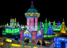 Visitors view buildings made from blocks of ice for the Harbin International Ice and Snow Festival in Harbin in northeastern China's Heilongjiang province, on Wednesday, Jan. 4, 2012. The festival is scheduled to officially open on Thursday night, Jan. 5.  (AP Photo/Andy Wong)