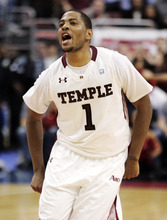 Temple's Khalif Wyatt celebrates during the last seconds of the second half of an NCAA college basketball game against Duke, Wednesday, Jan. 4, 2012, in Philadelphia. Wyatt contributed 22 points as Temple won 78-73. (AP Photo/Tom Mihalek)