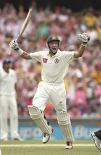 Australia's cricket player Mike Hussey celebrates hitting a century on the third day of the second test match against India at the Sydney Cricket Ground in Sydney, Australia, Thursday, Jan. 5, 2012.(AP Photo/Rob Griffith)