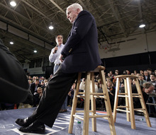 Republican presidential candidate former Massachusetts Gov. Mitt Romney campaigns during a town hall style meeting in Manchester, N.H., as Sen. John McCain, R-Ariz,, listens Wednesday, Jan. 4, 2012. (AP Photo/Stephan Savoia)