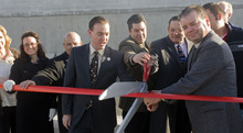 Al Hartmann     The Salt Lake Tribune West Valley City Mayor Mike Winder, center, West valley City employees and Alan Anderson President/CEO of Chamber West, right, cut a ribbon announcing the completion of work on the I-215/3500 South interchange. The new frontage road creates a