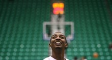 Steve Griffin  |  The Salt Lake Tribune  Jazz forward Jeremy Evans smiles as he warms up with Alec Burks  and Gordon Hayward before their game against the Bucks at EnergySolutions Arena in Salt Lake City, Utah  Tuesday, January 3, 2012.