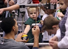 Steve Griffin  |  The Salt Lake Tribune  Utah Jazz guard Devin Harris signs mini basketballs for young fan's  following warm-up before game against the Bucks at EnergySolutions Arena in Salt Lake City, Utah  Tuesday, January 3, 2012.