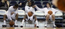 Steve Griffin  |  The Salt Lake Tribune  Jazz players Alec Burks, Jeremy Evans and Gordon Hayward laugh on the bench before they warm-up before their game against the Bucks at EnergySolutions Arena in Salt Lake City, Utah  Tuesday, January 3, 2012.