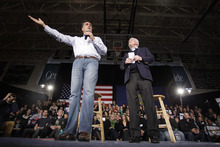 Stephan Savoia  |  The Associated Press  Republican presidential candidate and former Massachusetts Gov. Mitt Romney, accompanied by Sen. John McCain, R-Ariz., campaigns during a town hall style meeting in Manchester, N.H., on Wednesday.