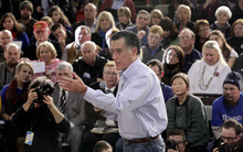 Stephan Savoia  |  The Associated Press  Republican presidential candidate, former Massachusetts Gov. Mitt Romney campaigns during a town hall style meeting in Manchester, N.H., on Wednesday.