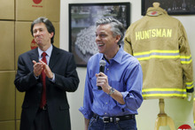 Matt Rourke  |  The Associated Press  Republican presidential candidate and former Utah Gov. Jon Huntsman, right, accompanied by Don Welch president and CEO of Globe Manufacturing, makes remarks during an event at Globe Manufacturing on Wednesday in Pittsfield, N.H.