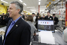 Matt Rourke  |  The Associated Press  Republican presidential candidate and former Utah Gov. Jon Huntsman campaigns at Globe Manufacturing on Wednesday in Pittsfield, N.H.