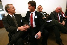 Leah Hogsten | The Salt Lake Tribune   South Jordan City  mayoral candidates Scott Osborne (left) and Mark Woolley (center) share a laugh with the other 17 candidates waiting in a room to address the council. Osborne had made an earlier joke that although he was number 13 in line to address the council, he had never been a suspicious person. South Jordan City Council chose Scott Lee Osborne to lead the city as mayor, Tuesday, January 3, 2012, replacing Kent Money, who is stepping down. All 19 applicants spoke at Tuesday's council meeting.