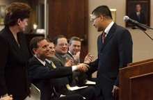 Leah Hogsten | The Salt Lake Tribune   West Valley City new council member Tom Huynh gets a hearty handshake from Mayor Mike Winder during the new council members swearing-in, Tuesday, January 3, 2012. Huynh was one of three new council members.