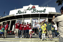 Wisconsin and Oregon fans pose for photos before the Rose Bowl NCAA college football game, Monday, Jan. 2, 2012, in Pasadena, Calif. (AP Photo/Matt Sayles)