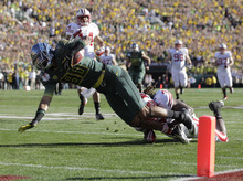 Oregon's Lavasier Tuinei takes the ball to the 1-yard line during the first half of the Rose Bowl NCAA college football game against Wisconsin, Monday, Jan. 2, 2012, in Pasadena, Calif.  (AP Photo/Jae C. Hong)