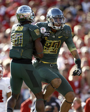 Oregon's Lavasier Tuinei, right, celebrates with Rahsaan Vaughn after bringing the ball to the 1-yard line during the first half of the Rose Bowl NCAA college football game against Wisconsin on Monday, Jan. 2, 2012, in Pasadena, Calif. Oregon scored on the next play.  (AP Photo/Matt Sayles)