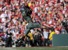 Oregon's Josh Huff pulls in a pass during the first half of the Rose Bowl NCAA college football game against Wisconsin, Monday, Jan. 2, 2012, in Pasadena, Calif. (AP Photo/Mark J. Terrill)