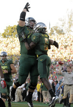 Oregon De'Anthony Thomas (6) celebrates his 64-yard touchdown with Mark Asper (79) during the second half of the Rose Bowl NCAA college football game against Wisconsin, Monday, Jan. 2, 2012, in Pasadena, Calif.  (AP Photo/Jae C. Hong)